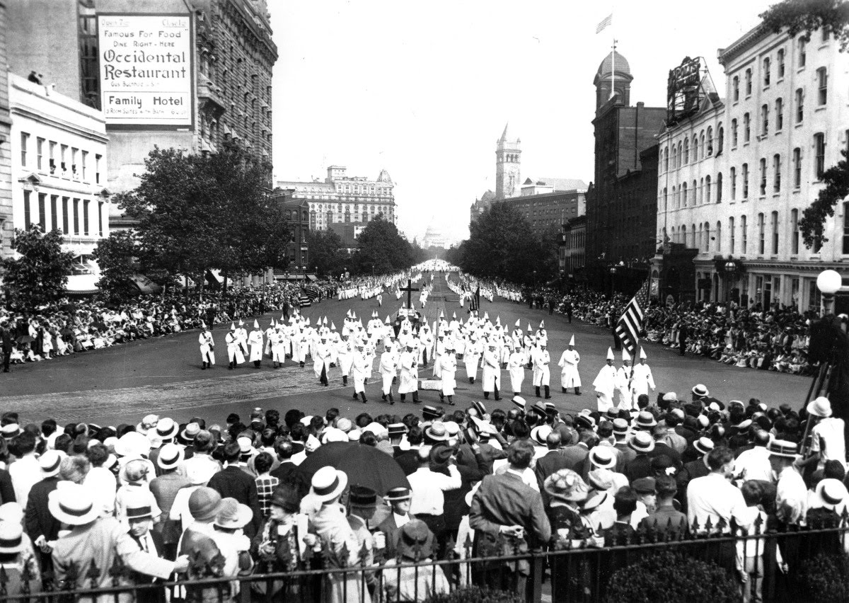 The Ku Klux Klan marches down Pennsylvania Ave. past the Treasury Building in Washington D.C. in 1925.  (AP Photo)